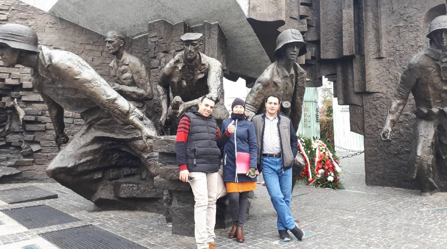 "Step in Warsaw - City guide to Warsaw. This is a great idea to combine a business trip with sightseeing! My business tourists from Egypt from ALPLA company and their first ""tourist"" question: ""Are you from Poland? Why are you dressed so warmly?"". Besides ""Siberia clothes"" I also had a thermal mug:). We are at the Warsaw Uprising Monument. Warszawa, October 2018."