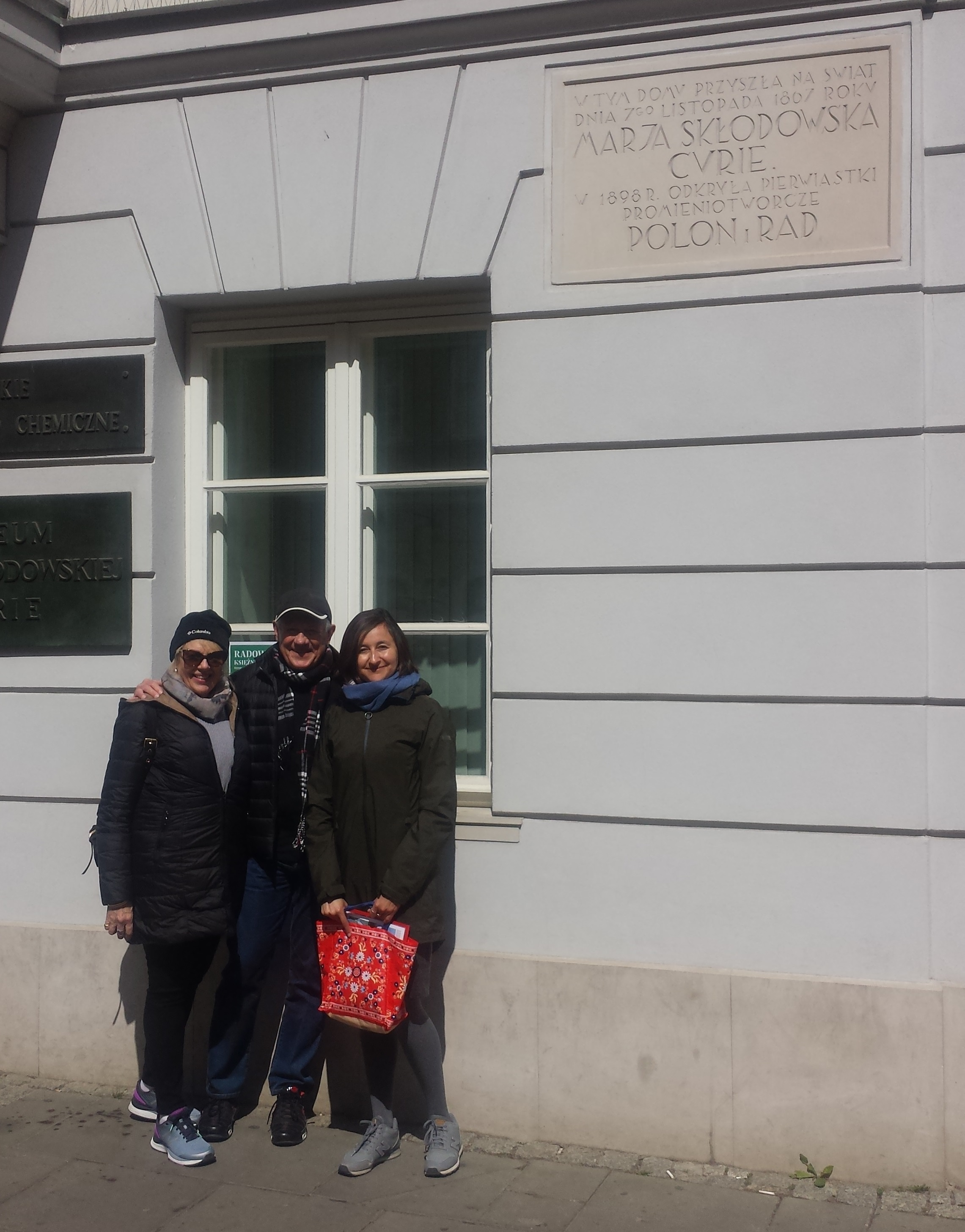Step in Warsaw - City guide to Warsaw. With my lovely tourists from Brisbane (Australia) in front of the Maria Skłodowska-Curie's birthplace, which houses a museum devoted to her life and work. Warsaw, 03.05.2019.