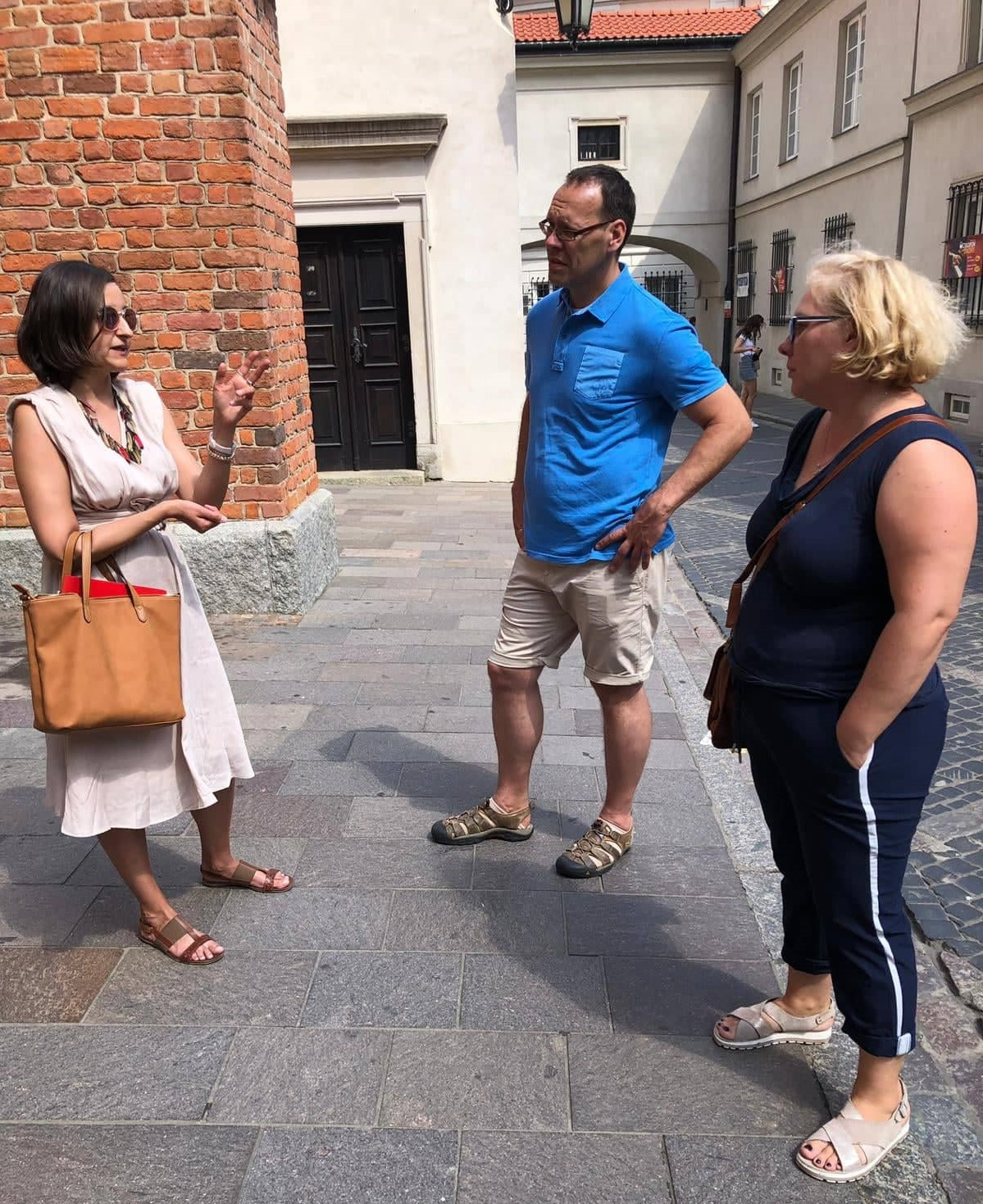 "Step in Warsaw - City guide to Warsaw. Warsaw for everyone, the younger and the older ones. That kind of Polish-German tourist group came from Germany, from Munich. At work: ""Saint John the Baptist Archcathedral is one of three coronation churches in Poland"". Warsaw, 08.08.2019."