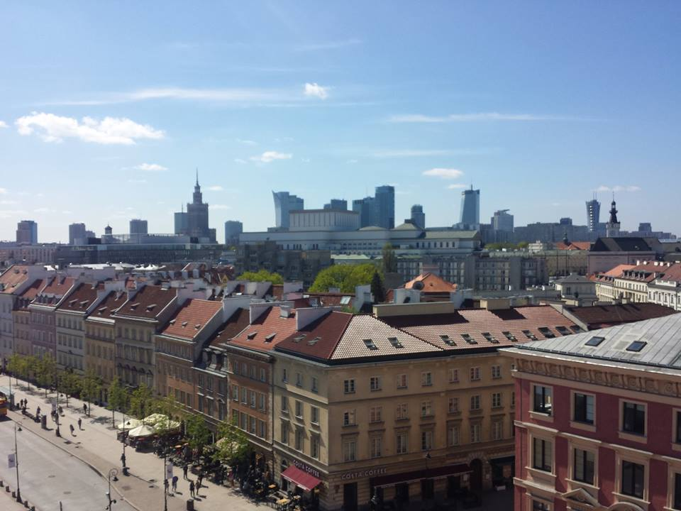 Step in Warsaw - City guide to Warsaw. The mixed architecture of Warsaw. A beautiful view from the St. Anne's Church tower (68 Krakowskie Przedmieście Street). Warsaw, April 2018.